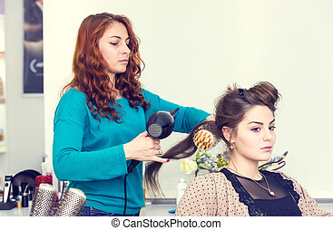 woman in a beauty salon doing hair