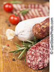 Smoked sausage with rosemary and peppercorns tomatoes and...