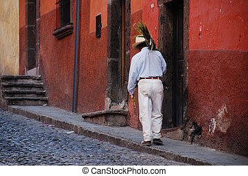 Man carrying palm branches, Mexico. - Man carrying palm...