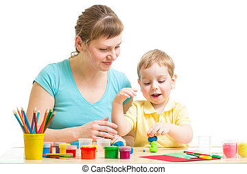 Parent and child plasticine modeling together isolated on white