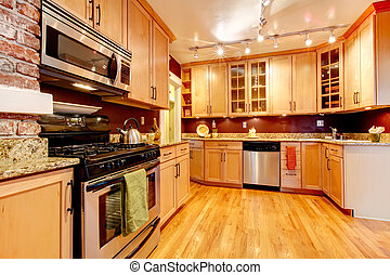 Bright kitchen room with brick designed wall