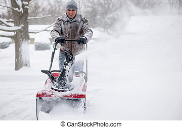 Man using snowblower in deep snow - Man using snowblower to...