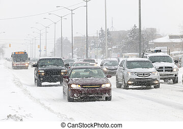 Winter driving - Cars driving on slippery road during heavy...