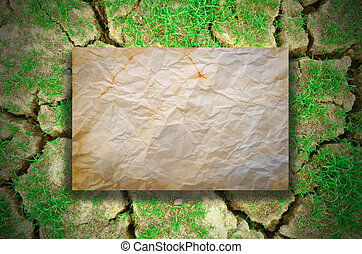 dry cracked earth and  crumpled  pape rold