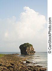 Chuanfan Rock at coastline - Chuanfan Rock, famous coral...