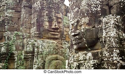 Huge stone faces on the towers of the ancient temple. Bayon....