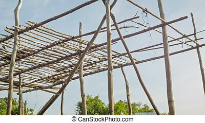 Framework for a wooden house on piles Cambodian village -...