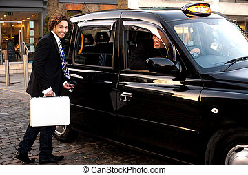 Man opening door of taxi cab - Young male passenger opening...