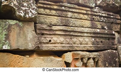 Stone blocks from the ancient wall of the temple. Angkor....