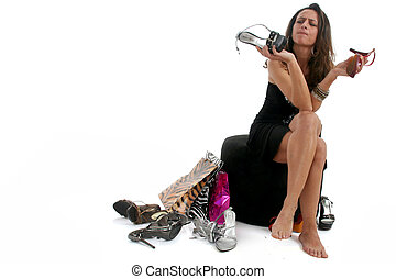 Woman buying shoes - Full body view of lovely woman sitting...
