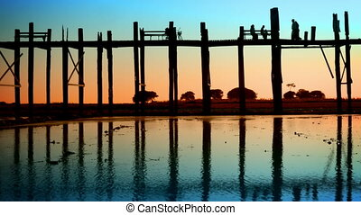 People on the old teak bridge Burma Mandalay sunset - Video...