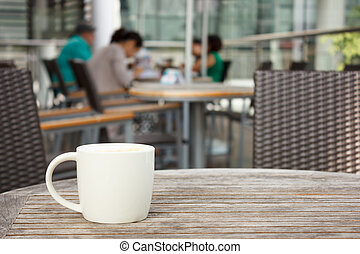 cup of coffee at coffee shop - cup of coffee on table at...