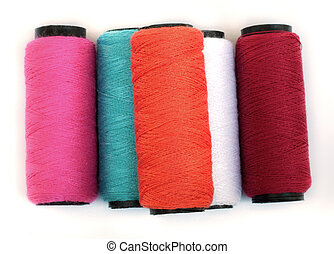 Spool of coloured thread - Spool of coloured thread isolated...