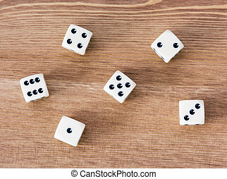 Casino dices on a wooden table. Straight.