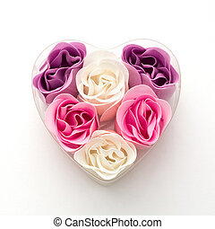Little heart made of fabric flowers. Symbol of love.