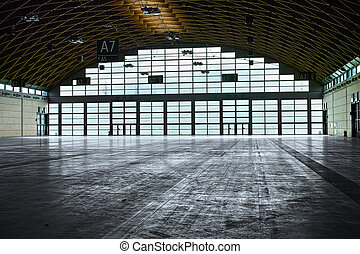 Hangar interior with natural and artificial light