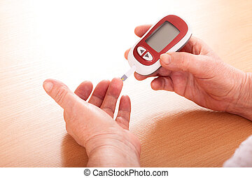 Woman makes testing high blood sugar. - Woman makes...