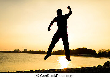 young man jumping off a cliff with his powerful feeling