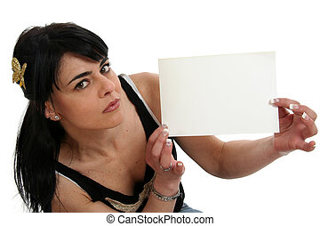 Your message here - Portrait of young woman holding a blank...