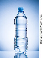 Plastic bottle of drinking water isolated on blue background