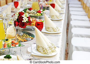 Wedding reception tableware and food waiting for guests