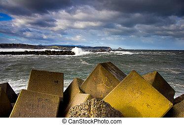 breakwater - View of a breakwater in rough seas