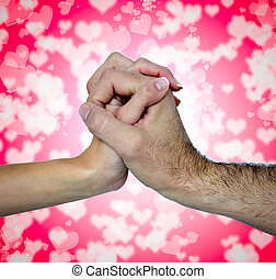 clasped hands with romantic background