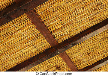 Reedy roof with wooden log - vintage Reedy roof with wooden...