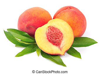Sweet peach with leaves close up on white