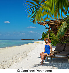 Woman in blue dress on a beach at Maldives - Woman in blue...