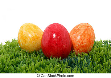 three easter eggs on grass - three easter eggs on green...