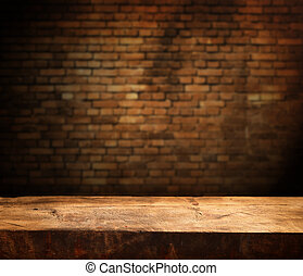 empty table - Empty wooden table and brick wall in...
