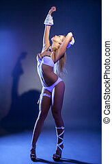 Impressive slim dancer posing in ultraviolet light - Image...