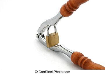 cracking - a nutcracker cracking a padlock