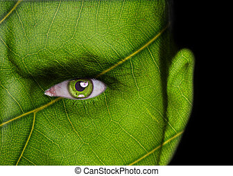 Nature concept - man face covered with leaf texture