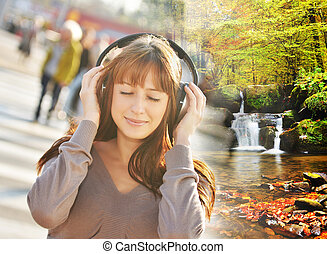 Music concept - Woman listening relaxating music in the city...