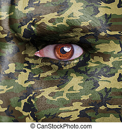 Soldier - Army camouflage painted on angry soldier face