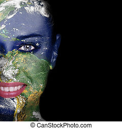 Nature concept -woman face covered with earth photo