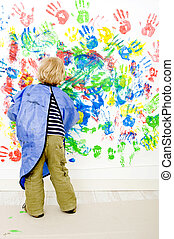 Finger painter - A young boy enjoying himself at...