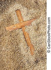 Forgotten Wooden Cross on Sand Texture Background -...