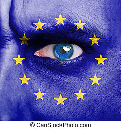 European Union flag painted on man face