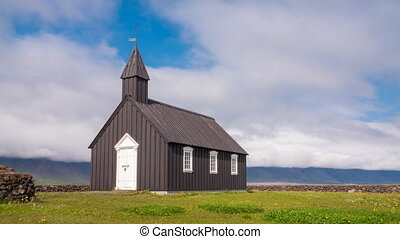 Wooden church - 4K Timelapse of black wooden church in front...