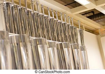 several toilet brushes on shelf