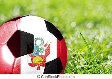 soccer background - Soccer ball on grass with flag of Peru...