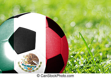 soccer background - Soccer ball on grass with flag of Mexico...