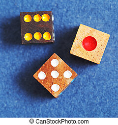 top view of three wooden gambling dices