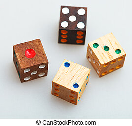 four wooden gambling dices on white table