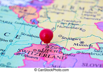 Red Pushpin on Map of Switzerland - Round red thumb tack...