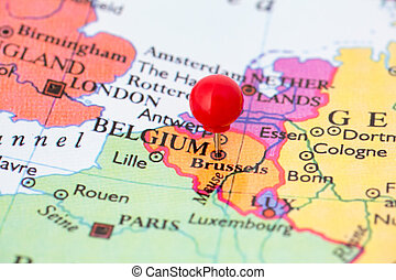 Red Pushpin on Map of Belgium - Round red thumb tack pinched...