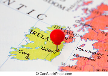 Red Pushpin on Map of Ireland - Round red thumb tack pinched...
